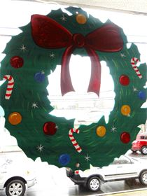 Hand cut and hand painted Christmas Wreath